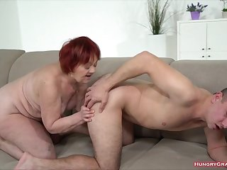 Redhead grandma gets a dick to play with
