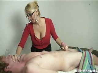 Provocative blonde palpate able takes her clients dick in her fingertips