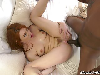 The big black dick suits this ginger's pussy just wonderful