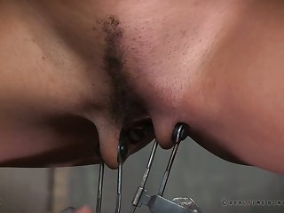 Horn-mad submissive chick gets vicious weighted clamps on her pussy lips