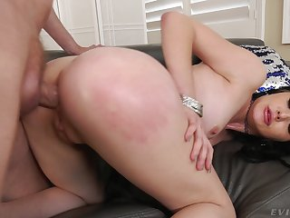 Elegant brunette sits exceeding top and rides the big dong with her ass