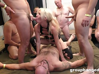 Blonde bitch shares in guestimated gangbang with older white lads